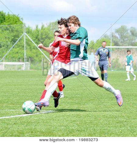 KAPOSVAR, HUNGARY - MAY 9: Milan Mayer (in green) in action at the Hungarian National Championship under 15 game between Kaposvari Rakoczi and Nagykanizsa May 9, 2010 in Kaposvar, Hungary.
