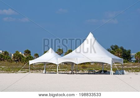 White tents on the beach preparing for a ceremony, Clearwater Beach, Florida, USA