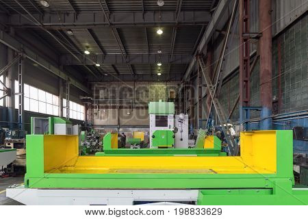 Surface grinding machine at the stage of assembly. Modern production of grinding machines.