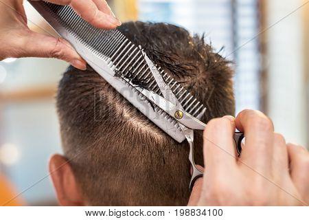 Мen's hair cutting scissors in a beauty salon.