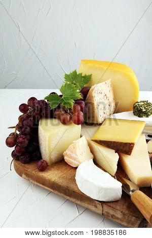 Cheese Platter With Different Cheese And Grapes