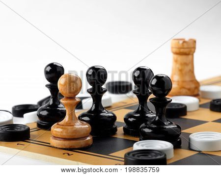 The chess pieces and checkers placed on the chessboard. White background