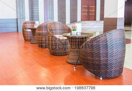 Rattan chair for reception in the hall.