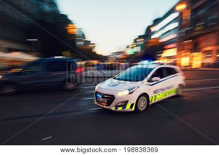 PRAGUE CZECH REPUBLIC - JUNE 27 2017: The patrol of Municipal Police of the City of Prague (in blurred motion) respond to an emergency call on June 27 2017.