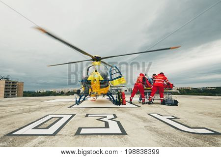 HRADEC KRALOVE CZECH REPUBLIC - JUNE 17 2017: Team of the Helicopter Emergency Medical Service passes the patient to the Emergency on the roof University Hospital in Hradec Kralove on June 17 2017.