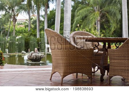 Tropical patio furniture on a picturesque backdrop.