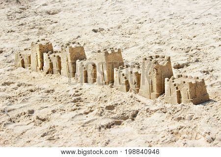 sandcastle on the beach in a summer day