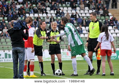 KAPOSVAR, HUNGARY - MAY 20: Krisztian Zahorecz (in green-white) shake hands at a Hungarian National Championship soccer game Kaposvar vs. Diosgyor - May 20, 2010 in Kaposvar, Hungary.