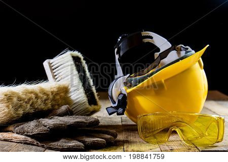 Yellow Helmet And Carpenter Tools. Carpenter And Old Wooden Table.