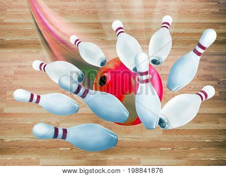 Bowling ball through pins flying fast for strike..