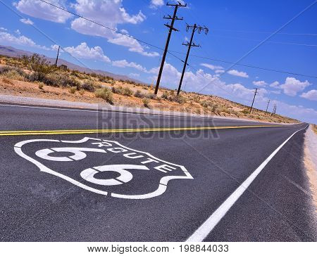 U.S. Route 66 highway with sign on asphalt on California.