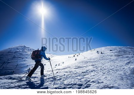Winter sport for one Tourist on trip in snowy mountains Background winter sport Symbol of winter sports in mountains Skialpinist on snowy mountains