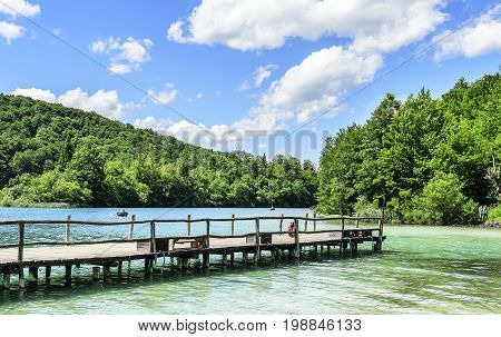 Wooden pier - JUNE 29: Wooden pier on the Plitvice Lakes in the summer day. June 29, 2017. Croatia. Plitvice Lakes.
