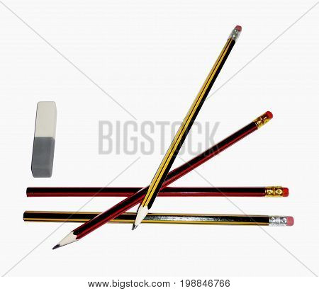 three pencils with an eraser isolated on a white background