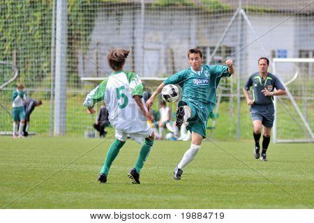 KAPOSVAR, HUNGARY - MAY 29: Mark Blatt (5) in action at the Hungarian National Championship under 15 game between Kaposvari Rakoczi and Paks May 29, 2010 in Kaposvar, Hungary.
