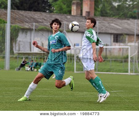 KAPOSVAR, HUNGARY - MAY 29: Bence Kovacs (L) in action at the Hungarian National Championship under 15 game between Kaposvari Rakoczi and Paks May 29, 2010 in Kaposvar, Hungary.