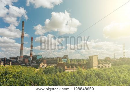 Plant for the production of synthetic rubber in Efremov, Russia, industrial landscape in sunlight, plant or factory with pipes concept, toned