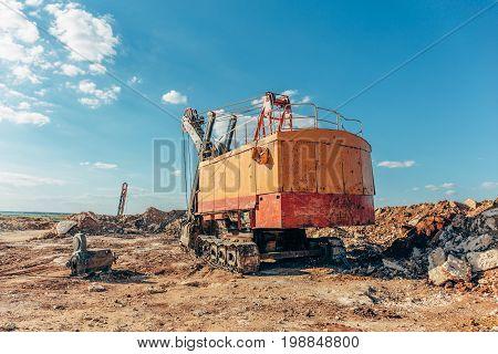 Big yellow excavator, quarry machine and quarry equipment for mining, toned