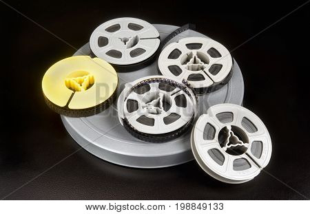 Old time 8mm film and film canisters.