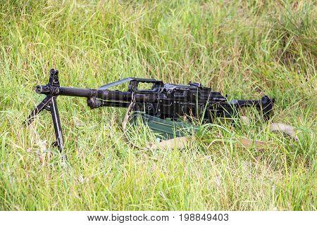Machine gun Pecheneg. The Machinegun is in the grass. Served in the Russian Army