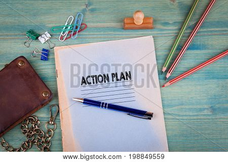 Action Plan concept. Notebook on a bright green background. Office stationery accessories.