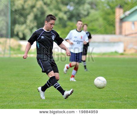 KAPOSVAR, HUNGARY - MAY 29: Bence Balogh (L) in action at the Hungarian National Championship under 19 game between Kaposvari Rakoczi and Barcsi FC May 29, 2010 in Kaposvar, Hungary.