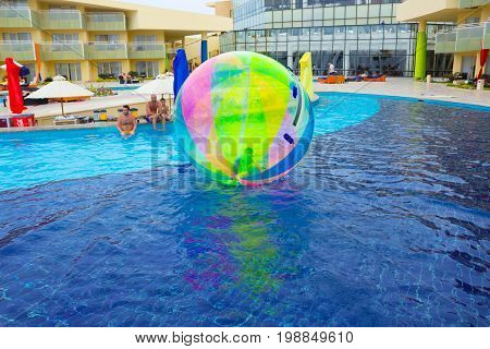 Sharm El Sheikh, Egypt - April 09, 2017: The boy in an inflatable balloon, having fun on the water at Sharm El Sheikh, Egypt - April 09, 2017. The ball in the water - fascinating summer attractions for children. Water zorbing.