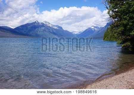 Montana's Lake McDonald on a sunny day in Glacier National Park.