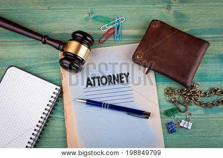 Attorney concept. Notebook on a bright green background. Office stationery accessories.