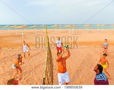 Sharm El Sheikh, Egypt - April 9, 2017: Tourists play volleyball at the hotel on the beach at Sharm El Sheikh, Egypt on April 9, 2017