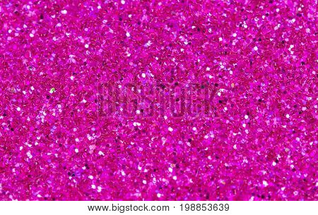 Hot pink abstract background. Pink glitter closeup photo. Pink shimmer wrapping paper. Sparkling glitter festive backgrop. Valentine day greeting card or wedding invitation template. Glitter decor