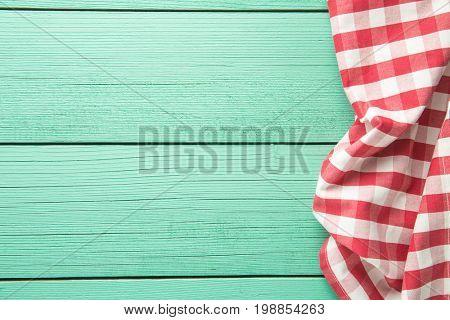 Tablecloth over colorful wooden table. Top view.