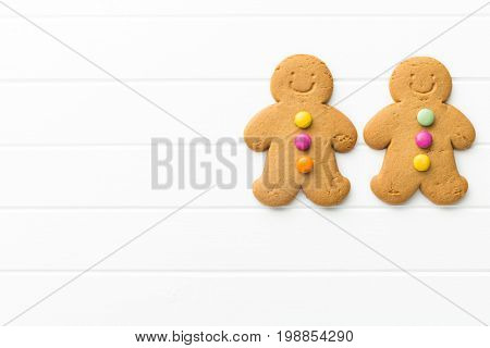 Two gingerbread men. Xmas gingerbread on white table. Top view.