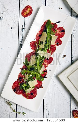 Meat Carpaccio with Rocket Salad and Parmesan Cheese