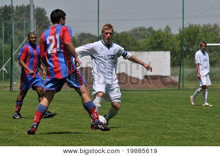 KAPOSVAR, HUNGARY - JUNE 12: Bence Fekete (21) in action at the Hungarian National Championship under 19 game between Kaposvar and Vasas June 12, 2010 in Kaposvar, Hungary.