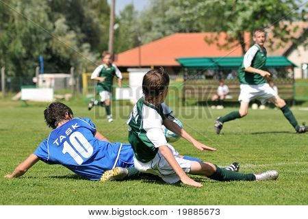 KAPOSVAR, HUNGARY - JUNE 12: Armin Prukner (C) in action at the Hungarian National Championship under 13 game between Kaposvari Rakoczi and Tatabanya June 12, 2010 in Kaposvar, Hungary.