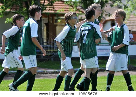KAPOSVAR, HUNGARY - JUNE 12: Kaposvar players celebrate a goal at the Hungarian National Championship under 13 game between Kaposvari Rakoczi and Tatabanya June 12, 2010 in Kaposvar, Hungary.