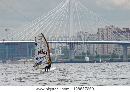 ST. PETERSBURG, RUSSIA - JULY 5, 2017: Windsurfing training in the Gulf of Finland near the yacht club of St. Petersburg. Yacht club organizes sailing classes for all ages and holds sports regattas
