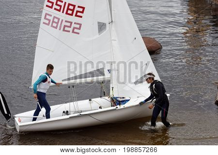 ST. PETERSBURG, RUSSIA - JULY 5, 2017: Training in sailing on 420 dinghy in the Gulf of Finland near the yacht club of St. Petersburg. Yacht club organizes sailing classes and holds sports regattas