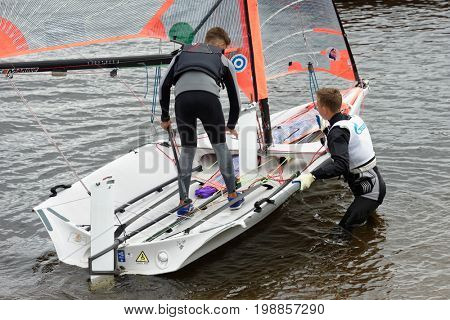 ST. PETERSBURG, RUSSIA - JULY 5, 2017: Training in sailing on 29er dinghy in the Gulf of Finland near the yacht club of St. Petersburg. Yacht club organizes sailing classes and holds sports regattas