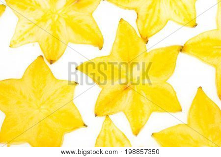 Star fruit on white isolated background translucent delicious natural sweet shape starfruit food texture detail macro close up carambola graphic pattern