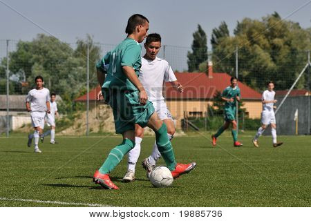 KAPOSVAR, HUNGARY - JUNE 12: David Rafael (in green) in action at the Hungarian National Championship under 15 game between Kaposvari Rakoczi and Tatabanya June 12, 2010 in Kaposvar, Hungary.