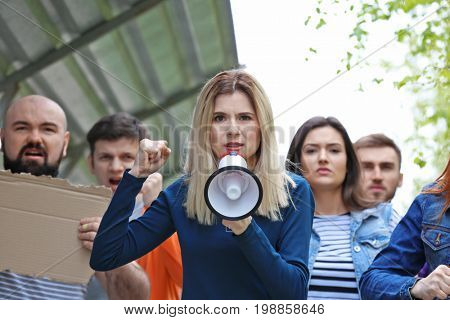 Group of protesting young people outdoors