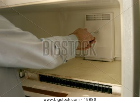 Guy Fixing Fridge