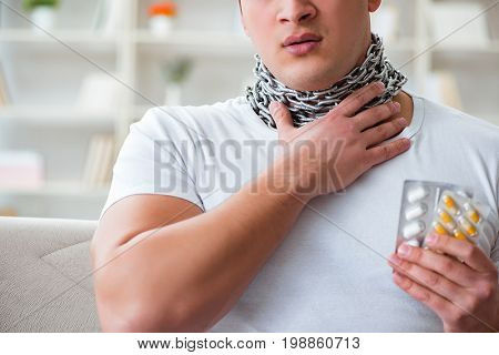 Young man suffering from sore throat