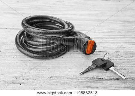 Bicycle lock on wooden background