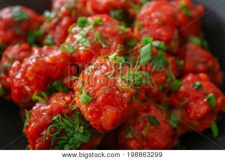 Delicious turkey meatballs and tomato sauce, closeup