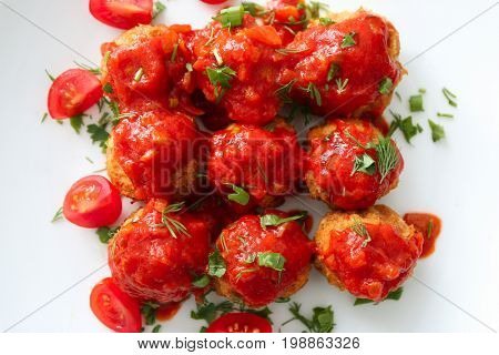 Plate with delicious turkey meatballs and tomato sauce, closeup