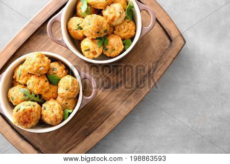 Ceramic dishes with delicious turkey meatballs on table