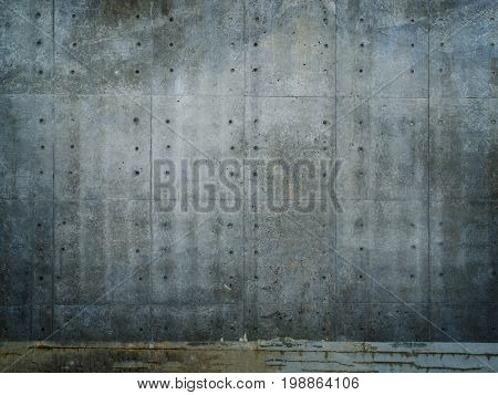 Grungy and smooth bare concrete wall with many concrete form dimples.